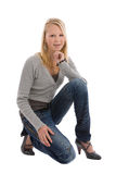Teenage girl. Cute blond teenage girl kneeling on white background Stock Photography