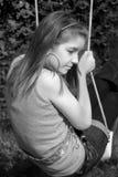 Teenage girl. On a swing Stock Photo