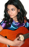 Teenage girl with acoustic guitar Stock Photos
