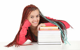 Teenage girl with african hairdo and pile of books Stock Photography