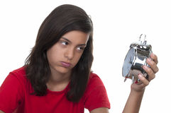 Teenage girl and the alarm clock Stock Photos