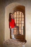 A teenage girl in an ancient abandoned Arab building Stock Photo