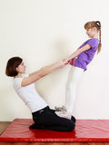Teenage girl ang a physiotherapist are doing an exercise royalty free stock photo