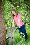 Teenage girl at apple tree Stock Photos