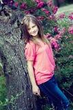 Teenage girl at apple tree Royalty Free Stock Image