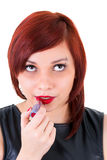 Teenage girl applying lipstick Royalty Free Stock Photos