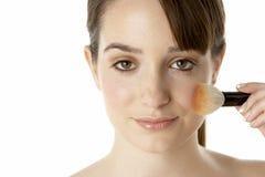 Teenage Girl Applying Make Up Stock Photography