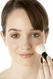 Teenage Girl Applying Make Up Royalty Free Stock Photography