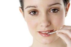 Teenage Girl Applying Make Up Royalty Free Stock Image