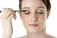 Teenage Girl Applying Make Up Stock Photography