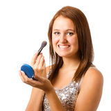 Teenage girl applying makeup or cosmetics Stock Images