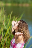 Teenage Girl With Arms Outstretched At Park Stock Photography