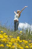 Teenage Girl With Arms Outstretched Standing Against Sky Stock Image