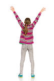 Teenage Girl With Arms Raised, Rear View Stock Photo