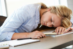 Teenage girl asleep in class Royalty Free Stock Images