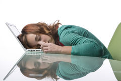 Teenage girl asleep on her laptop Stock Photo