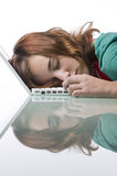 Teenage girl asleep on her laptop Stock Photography