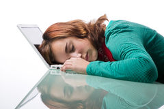 Teenage girl asleep on her laptop computer Royalty Free Stock Photography