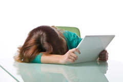 Teenage girl asleep on her laptop computer Royalty Free Stock Photo