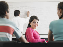 Teenage Girl Attending Lecture In Classroom Stock Photos