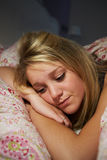 Teenage Girl Awake In Bed Suffering With Insomnia Stock Images