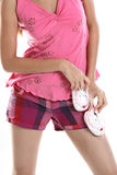 Teenage girl with baby shoes Royalty Free Stock Images