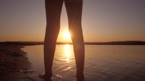 Teenage girl on background of setting sun. Carefree nightlife of children in adolescence stock footage
