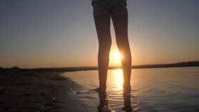 Teenage girl on background of setting sun. Carefree nightlife of children in adolescence stock video