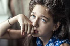 A teenage girl in a bad mood. Portrait of a girl who is depressed Stock Photos