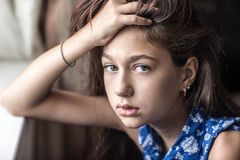 A teenage girl in a bad mood. Portrait of a girl who is depressed Royalty Free Stock Photo