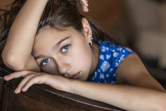 A teenage girl in a bad mood. Portrait of a girl who is depressed Stock Photo