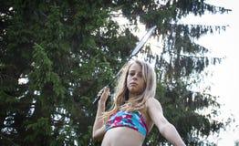Teenage girl with badminton racket royalty free stock photography