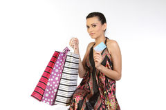 Teenage girl with  bags and credit card. Beautiful teenage girl with shopping bags and credit card Royalty Free Stock Photo