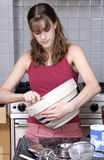 Teenage girl baking Stock Images