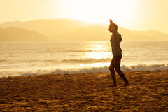 Teenage girl  balance slackline silhouette on the beach Stock Images