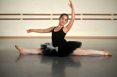 Teenage girl ballet dancer in a split Royalty Free Stock Photo
