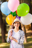 Teenage girl balloons Royalty Free Stock Photo