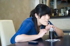 Teenage girl in bar Stock Image