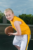 Teenage girl with basketball Stock Images