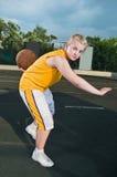 Teenage girl with basketball Royalty Free Stock Photos