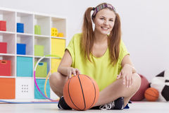 Teenage girl with basketball Royalty Free Stock Image