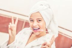 Teenage girl in bathroom with toothbrush. Morning and evening de Royalty Free Stock Images