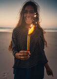 Girl with Fireworks. Teenage girl on the beach holding Fireworks Stock Images