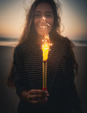 Girl with Fireworks. Teenage girl on the beach holding Fireworks Stock Photos