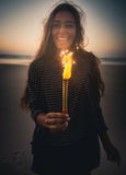 Girl with Fireworks. Teenage girl on the beach holding Fireworks Royalty Free Stock Photo