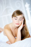 Teenage Girl on Bed Royalty Free Stock Images
