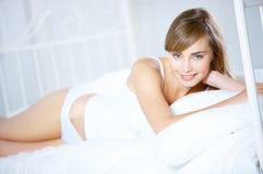 Teenage Girl on Bed Stock Photography