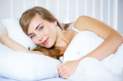 Teenage Girl on Bed Royalty Free Stock Photography