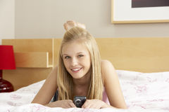 Teenage Girl In Bedroom With Mobile Phone Royalty Free Stock Photos