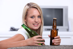 Teenage girl with beer royalty free stock image